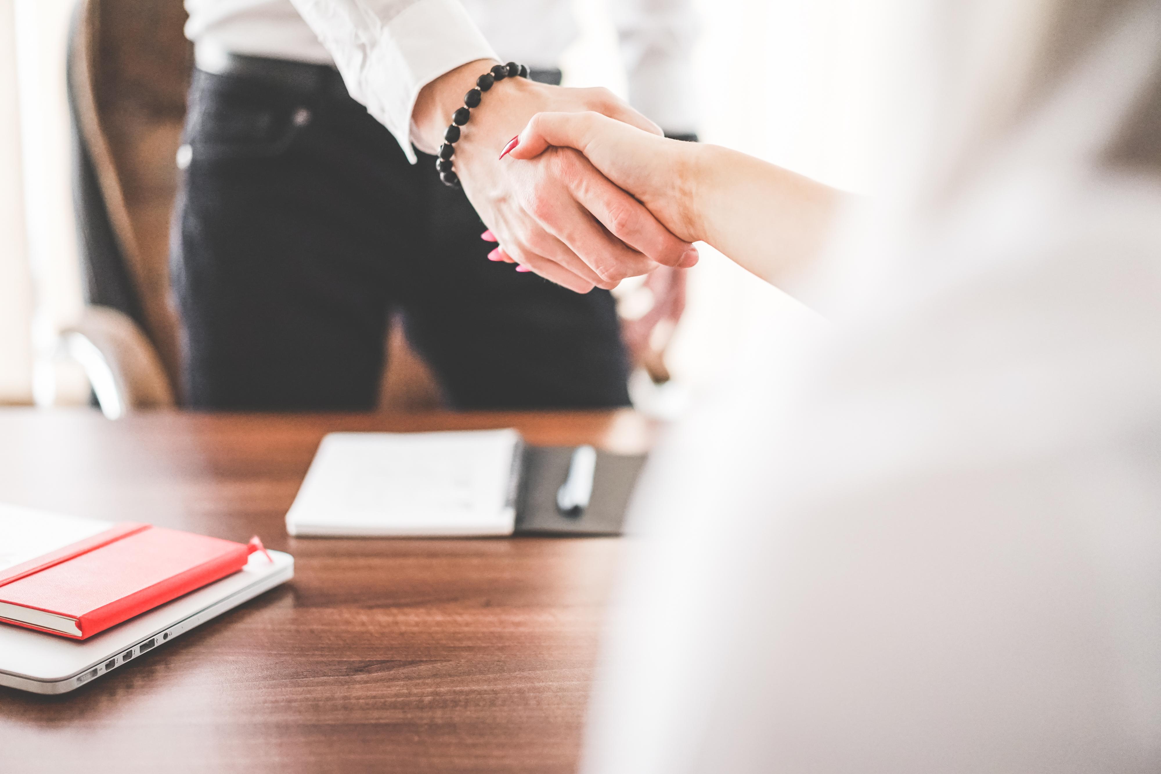 business-man-and-woman-handshake